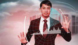 Composite image of unsmiling businessman touching Royalty Free Stock Photo