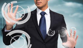 Composite image of unsmiling businessman touching Stock Images