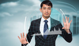 Composite image of unsmiling businessman touching Royalty Free Stock Photos