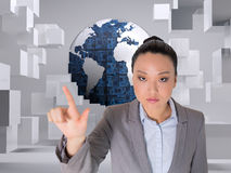 Composite image of unsmiling businesswoman pointing Stock Photography
