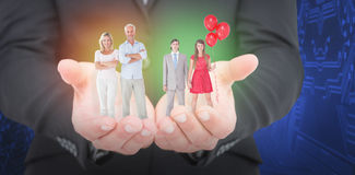 Composite image of unsmiling geeky couple standing hand in hand Stock Photos