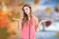 Composite image of unsure woman gesturing do not know sign Stock Photos
