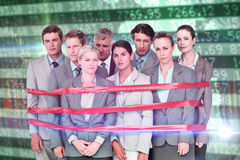 Composite image of upset business team fastened with adhesive tape Stock Photography