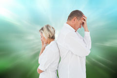 Composite image of upset couple not talking to each other after fight Royalty Free Stock Photography