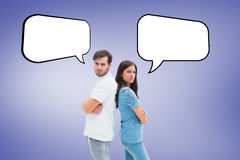 Composite image of upset couple not talking to each other after fight Royalty Free Stock Photo