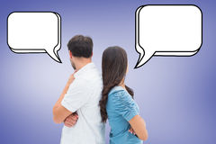 Composite image of upset couple not talking to each other after fight Stock Image