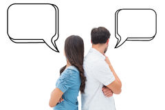 Composite image of upset couple not talking to each other after fight Royalty Free Stock Photos