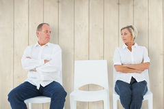 Composite image of upset couple not talking to each other after fight Royalty Free Stock Images