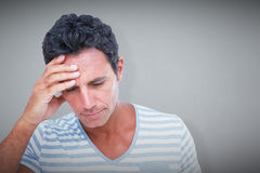 Composite image of upset man with hand on forehead Stock Photos