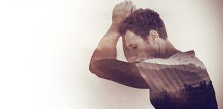 Composite image of upset man leaning on white background Royalty Free Stock Photo