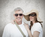 Composite image of vacationing couple Stock Images