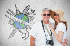 Composite image of vacationing couple. Vacationing couple against white background Stock Photos