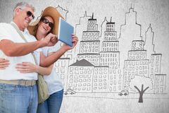 Composite image of vacationing couple taking photo. Vacationing couple taking photo against white background Royalty Free Stock Photos