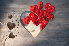 Composite image of valentines heart design. Valentines heart design against blue and orange sky with clouds Stock Photography