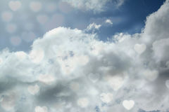 Composite image of valentines heart design. Valentines heart design against blue sky with clouds Stock Photography