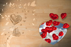 Composite image of valentines heart design. Valentines heart design against blue sky with clouds and sun Stock Image