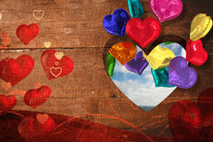 Composite image of valentines heart design. Valentines heart design against blue sky with white clouds Royalty Free Stock Images