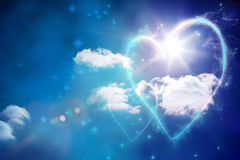 Composite image of valentines heart design. Valentines heart design against bright blue sky with clouds Royalty Free Stock Photography