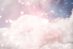 Composite image of valentines heart design. Valentines heart design against bright blue sky with clouds Royalty Free Stock Images