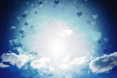 Composite image of valentines heart design. Valentines heart design against cloudy sky with sunshine Royalty Free Stock Photos