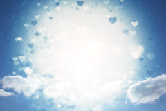 Composite image of valentines heart design. Valentines heart design against cloudy sky with sunshine Royalty Free Stock Photography
