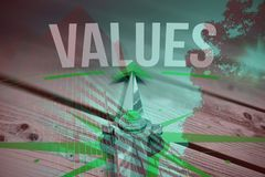 Composite image of values against digitally generated grey wooden planks. Values against digitally generated grey wooden planks against tree and building against stock image
