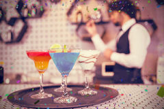 Composite image of various cocktails on serving tray in bar counter stock photography