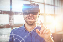 Composite image of various graphs and connectivity points. Various graphs and connectivity points against male business executive using virtual reality headset royalty free stock photos