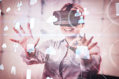 Composite image of various graphs and connectivity points. Various graphs and connectivity points against woman enjoying virtual reality headset royalty free stock photos
