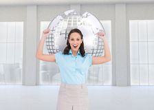 Composite image of victorious businesswoman posing Royalty Free Stock Photography