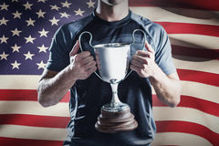Composite image of victorious rugby player holding trophy Stock Photography