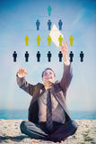 Composite image of victorious young businessman juggling with his tablet Royalty Free Stock Images