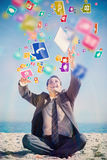 Composite image of victorious young businessman juggling with his tablet Royalty Free Stock Photography