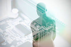 Composite image of view of a black character 3D. View of a black character against computer chip in circuit board 3D royalty free illustration