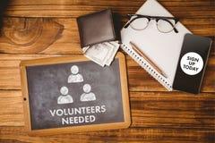 Composite image of volunteers needed. Volunteers needed against hipsters desk Royalty Free Stock Photos
