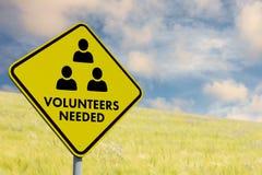 Composite image of volunteers needed. Volunteers needed against nature scene Stock Photo