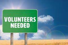 Composite image of volunteers needed. Volunteers needed against sunny brown landscape Royalty Free Stock Photos