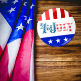 Composite image of vote button. Vote button against usa flag on table Stock Images