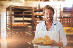 Composite image of waiter holding croissant on a tray Stock Images
