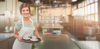 Composite image of waitress giving cup of coffee Stock Photos