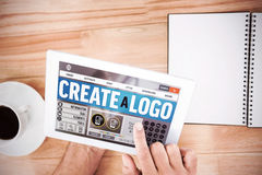 Composite image of webpage for create a logo. Webpage for create a logo against hands holding blank screen tablet Stock Image