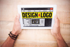 Composite image of webpage for create a logo. Webpage for create a logo against hands holding blank screen tablet Stock Photography