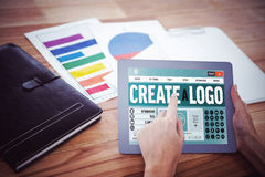 Composite image of webpage for create a logo. Webpage for create a logo against over shoulder view of hipster woman using tablet Royalty Free Stock Image