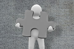 Composite image of white character holding jigsaw piece Royalty Free Stock Image
