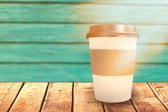 Composite image of white cup over white background Royalty Free Stock Photo