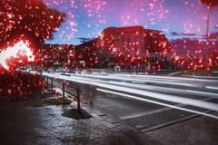 Composite image of white fireworks exploding on black background. White fireworks exploding on black background against light trails on city street Stock Photos