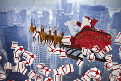 Composite image of white and red christmas presents. White and red christmas presents against image of a city landscape Stock Image