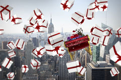 Composite image of white and red christmas presents. White and red christmas presents against city skyline Stock Image