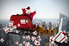 Composite image of white and red christmas presents. White and red christmas presents against city skyline Stock Photography