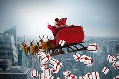 Composite image of white and red christmas presents. White and red christmas presents against cityscape Royalty Free Stock Images